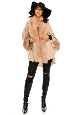 PC-072DP A knit poncho featuring a faux fur lined collar