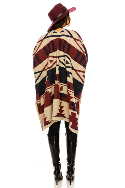 SCHAL30TP A knit cozy poncho featuring a tribal pattern