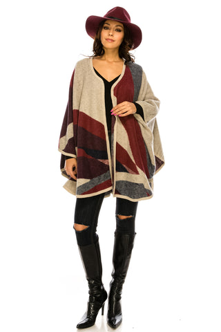 SCHAL31-4TP A knit poncho featuring a pattern block of alternating marled and solid patterns