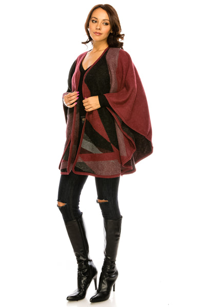SCHAL31-1WI A knit poncho featuring a pattern block of alternating marled and solid patterns