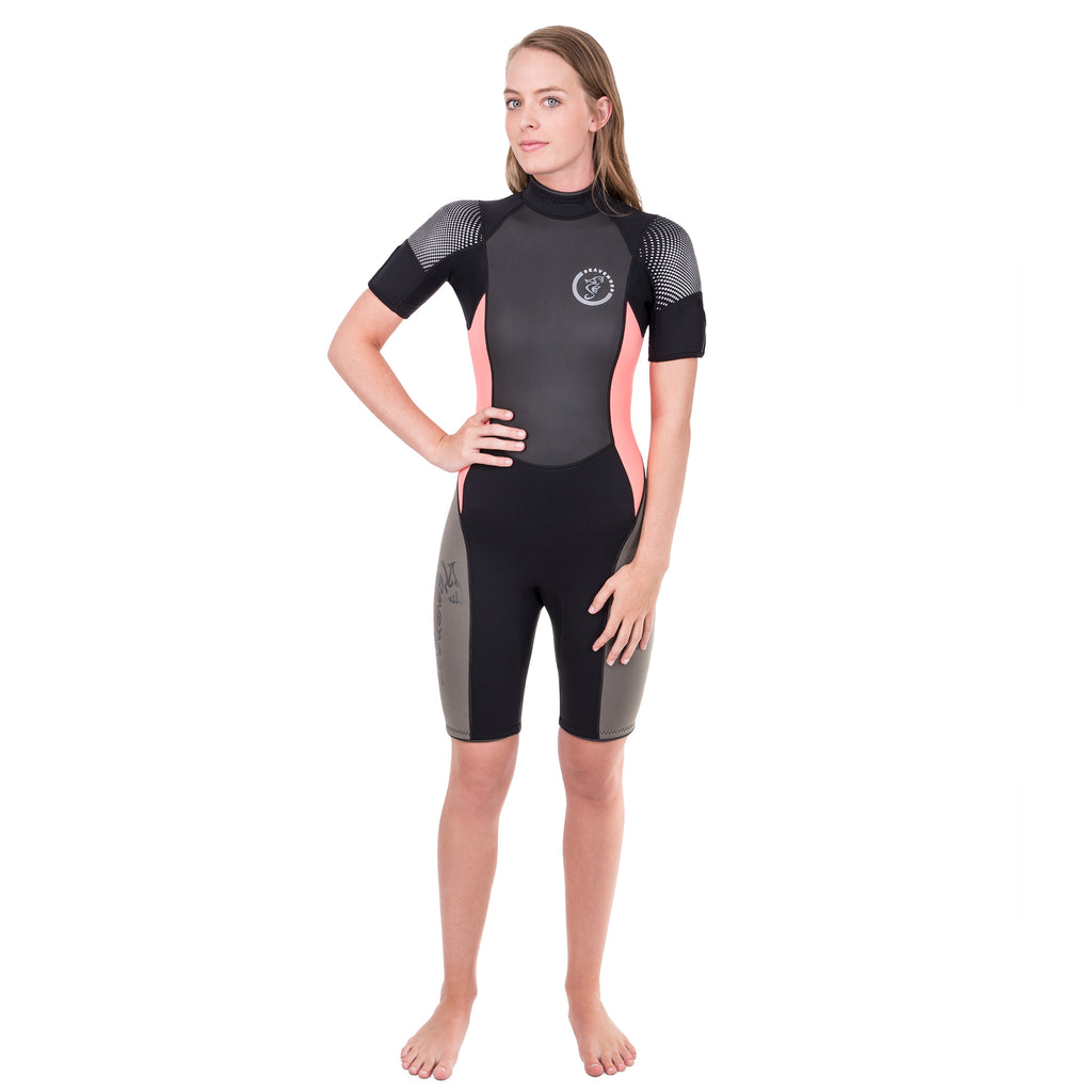 A black shorty wetsuit with taupe panels on the outer leg and coral side panels in 3mm neoprene.