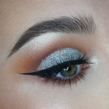 "@alygmua is wearing Glitter Lambs ""100% Educated"" silver holographic glitter eyeshadow in the eye makeup look she created."