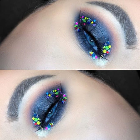 "@shanmacmua is wearing Glitter Lambs ""Billionaires Club"" chunky body glitter in inner and outer corner of her eye."