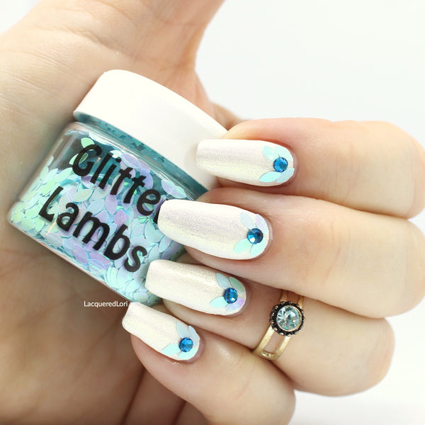 "Glitter Lambs ""Blue Fairy Wings"" Body Glitter used as nail art by @lacqueredlori Polishes used was Sparkle & Co. ""Lotta Colada"" topped with Glitter Lambs ""I Found an Oyster Pearl"" #nails #nailart #nailglitter #bluenails #blueglitternails #glitterlambs #nailglitters"