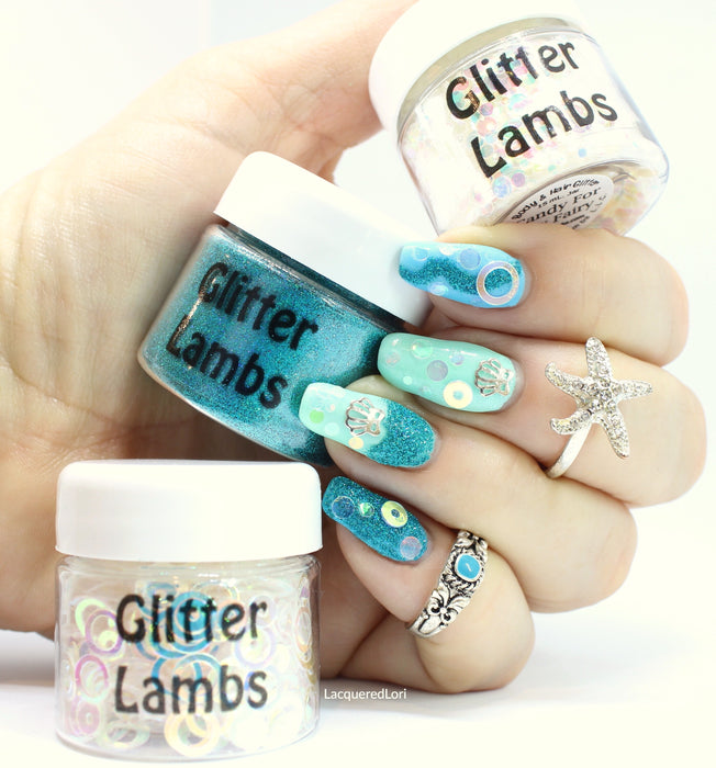 "@lacqueredlori is wearing Glitter Lambs ""Candy For My Fairy"", ""Confident"", and ""Water Bubbles"" glitter on her nails. Polishes used was Pretty Serious brand in ""Bunny Foo Foo"" and ""Doodle Bug"". #nails #nailart #naildesigns #glitternails #nailglitter #mermaidnails #nailswag #nailstagram #glitter #glitterlambs"