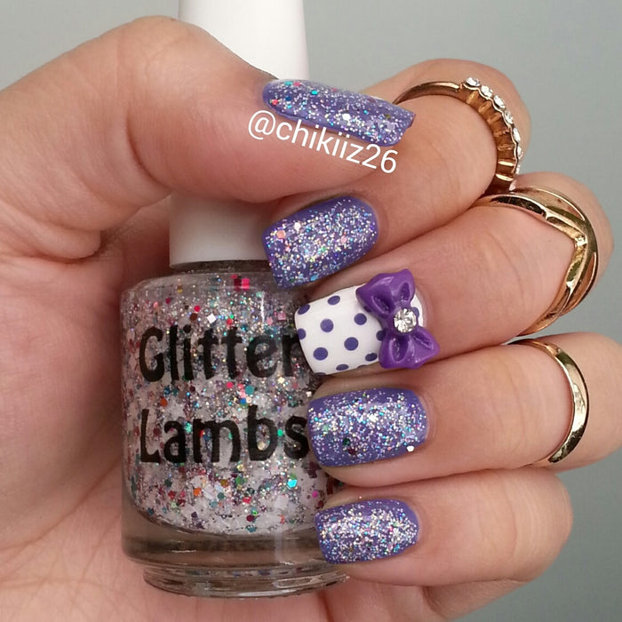 "Glitter Lambs ""Unicorns Love Sugar Cubes"" Glitter Topper Nail Polish worn by @lacqueredlori #nails #glitternails #unicornnailpolish #glitternailpolish #nailpolish #glittertopper #glitterlambs #unicornpolis"