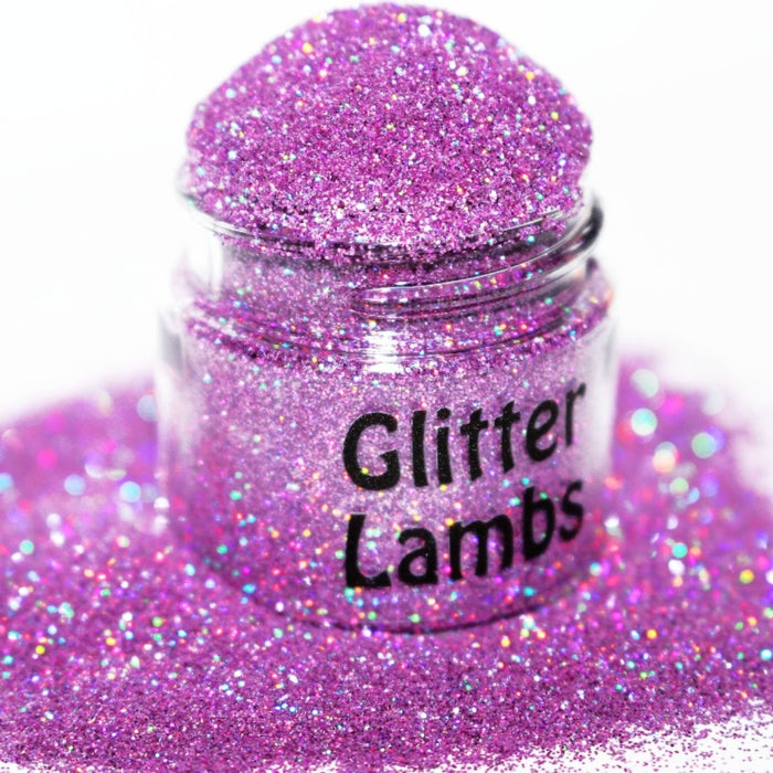 Here Kitty Kitty Glitter. A pink holographic glitter that is a size .008. Great for crafts, nails, resin, acrylic pouring, tumbler cups, body, etc. by GlitterLambs.com