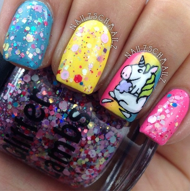 "Glitter lambs ""Unicorns Love Cotton Candy"" glitter topper nail polish has tiny metallic holographic hex & square glitters in red and blue, pastel hex in different sizes, matte white dots, and some scattered matte pink dots."