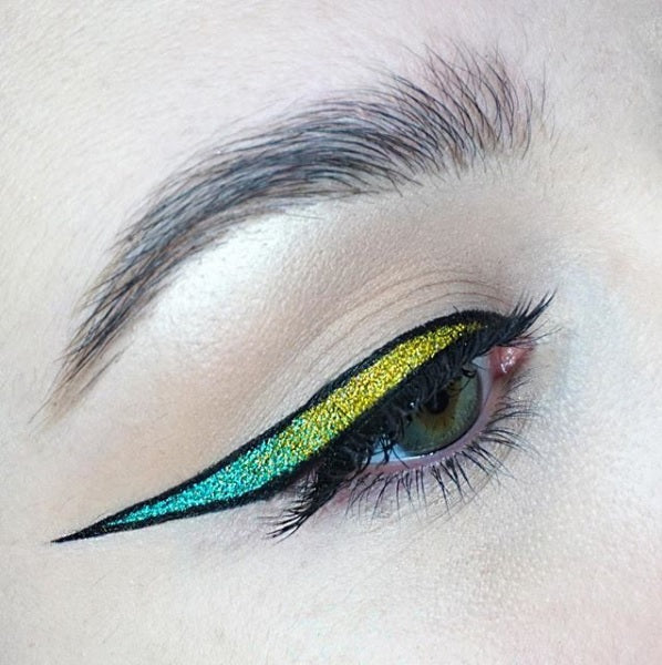 "@alygmua is wearing Glitter Lambs ""Virtual Reality"" glitter eyeshadow and ""Radioactive"" glitter eyeshadow"