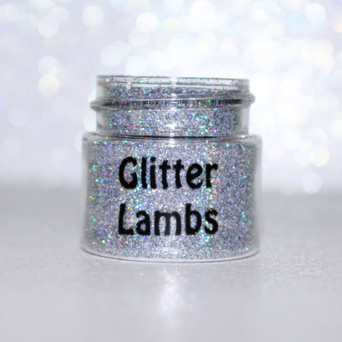 Twinkle The Star...Sucker glitter is a silver holographic glitter size .008. Great for crafts, nails, resin, tumbler cups, acrylic pouring, body, hair, etc. Jar is 15mL. by GlitterLambs.com