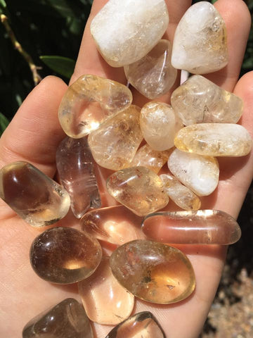 Citrine tumbles: natural on the bottom, heat-treated on the top