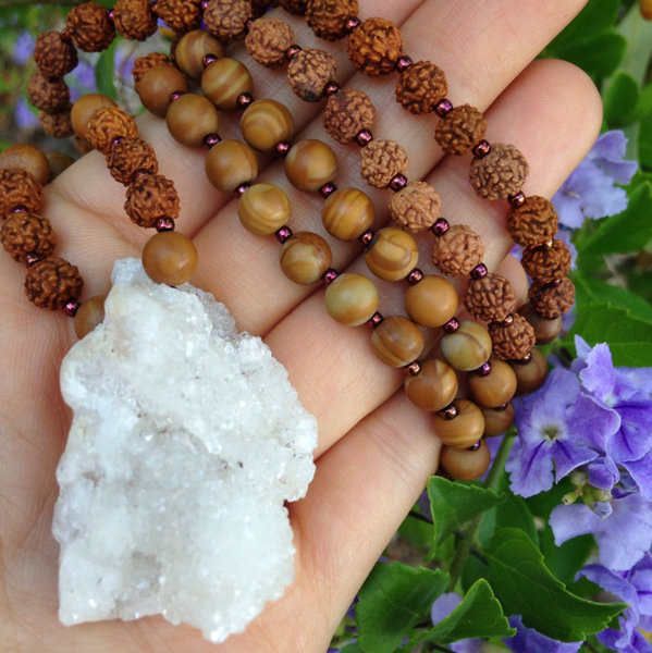 Mala made with a sparkly calcite cluster, jasper, and rudraksha beads