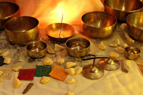 Singing bowls, tingshas, and incense are all tools you can use to clear your space and crystals
