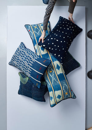 indigo baulé ikat lumbar cushion collection nomad design