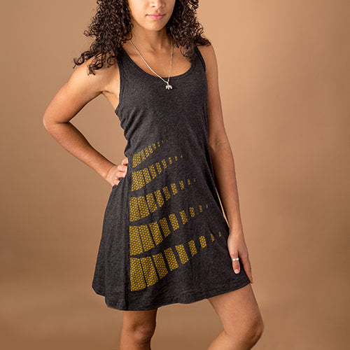 enthnic young female wearing charcoal gray racer back tank dress with flower of life pattern printed on bottom right corner