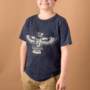 youth male wearing navy blue kids cut tee with inuit style eagle screen printed on front