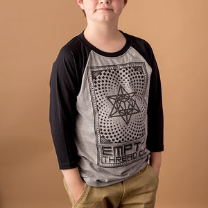 youth male wearing 3/4 sleeve baseball tee with black sleeves and grey body with merkaba design printed in black on front