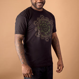 african american male wearing black t-shirt with sacred geometry design of psychodellic molecules printed in tan and green on front
