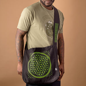 african american male wearing olive green ganesha tee and carrying black canvas market bag with lime green flower of life design print