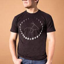 young white mail wearing black t-shirt with the phases of the moon printed in white on front