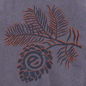 close up of back print on gray t-shirt of a pine sprag and a pinecone with empty logo