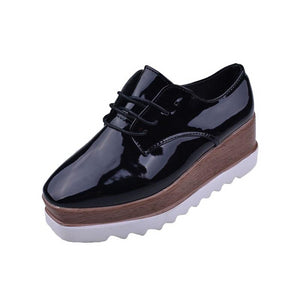 Women`s solid leather British oxfords