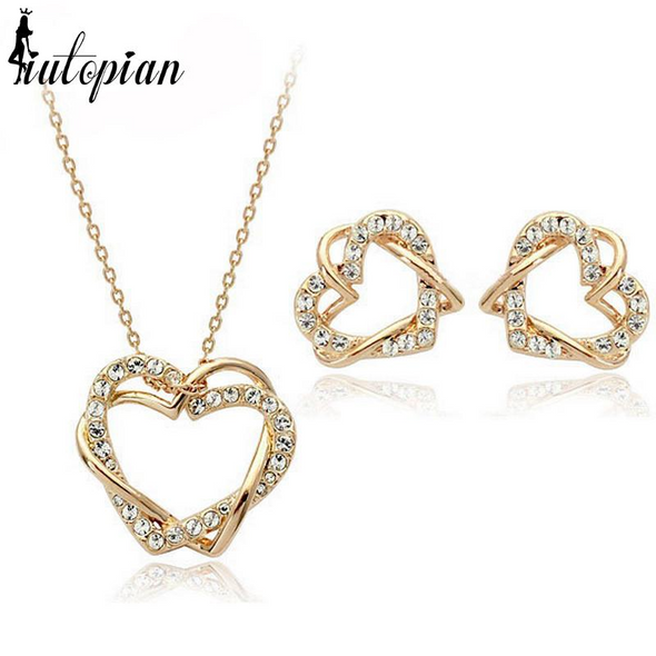infinity heart necklace and earrings in gold with diamonds