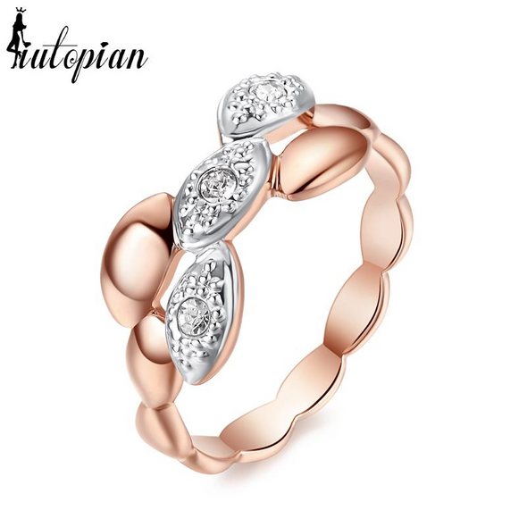 braided rose gold ring with diamonds