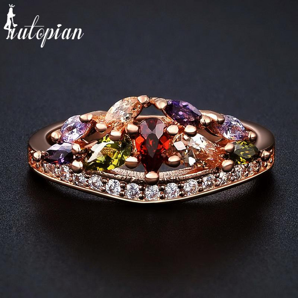 crown ring in gold with multi colored gemstones