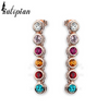 multi colored dangling earrings gold