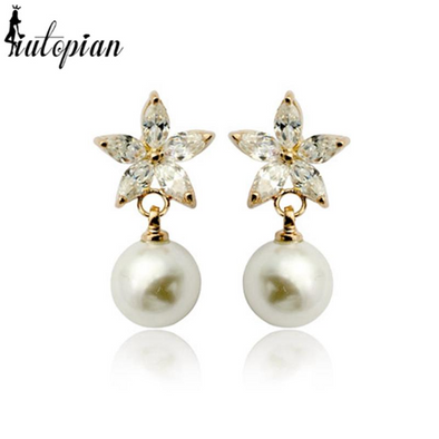 flower pearl earrings in gold and with diamonds