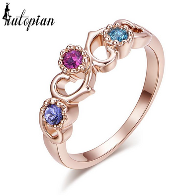 multi colored gemstone rose gold ring purple pink blue