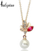 pearl leaf gold necklace with white pearl and pink and clear stones
