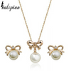 pearl and ribbon pendant gold necklace and earrings with diamonds