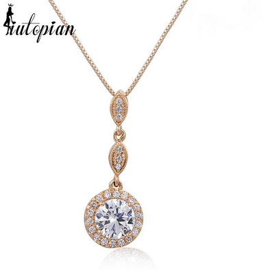 round diamond dangling pendant necklace in gold
