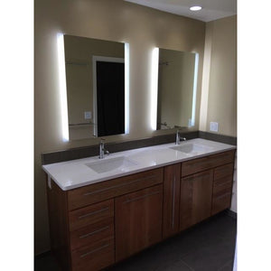 "28""x36"" LED bathroom mirror with lights angled view"