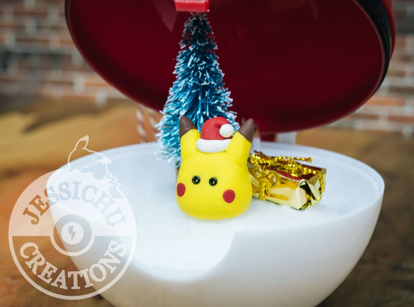 Pikachu Christmas Ornament.Pokemon Pokeball Christmas Tree Ornament With Santa Pikachu