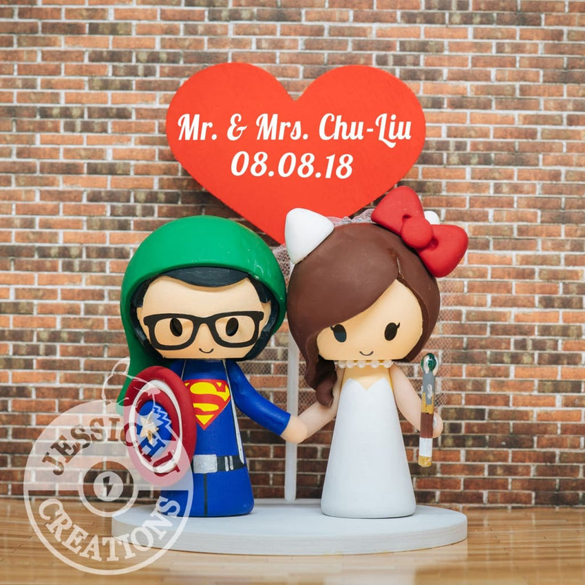 Superman with Captain America Shield and Link Hat and Hello Kitty with Doctor Who Sonic Screwdriver Wedding Cake Topper | DC x Sanrio x Marvel | Jessichu Creations