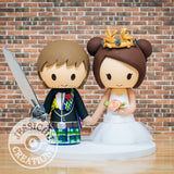 Scottish Groom holding gunblade and Bride wearing Margaery Tyrell crown Wedding Cake Topper | Final Fantasy x Game of Thrones | Jessichu Creations