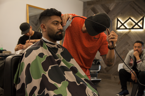 throne barbershop featuring illuzien hair cutting capes