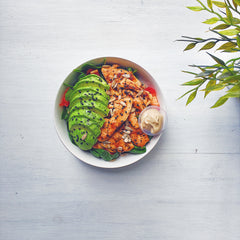 healthy lunch: grilled chicken and avocado nourish bowl