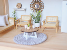 Rattan look lounges and arm chairs
