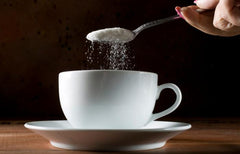 adding-sugar-to-an-espresso cup