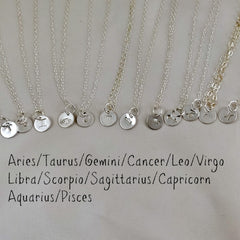sterling silver hand stamped astrology birth charm necklace