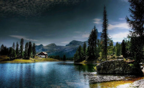 Lake in forest with house