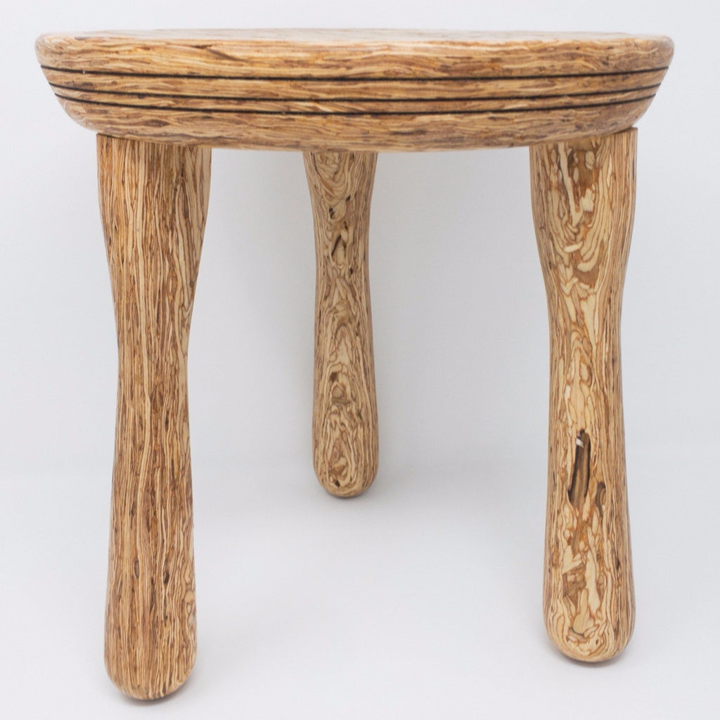 Three legged stool made of Parlam wood. Visually delightful.