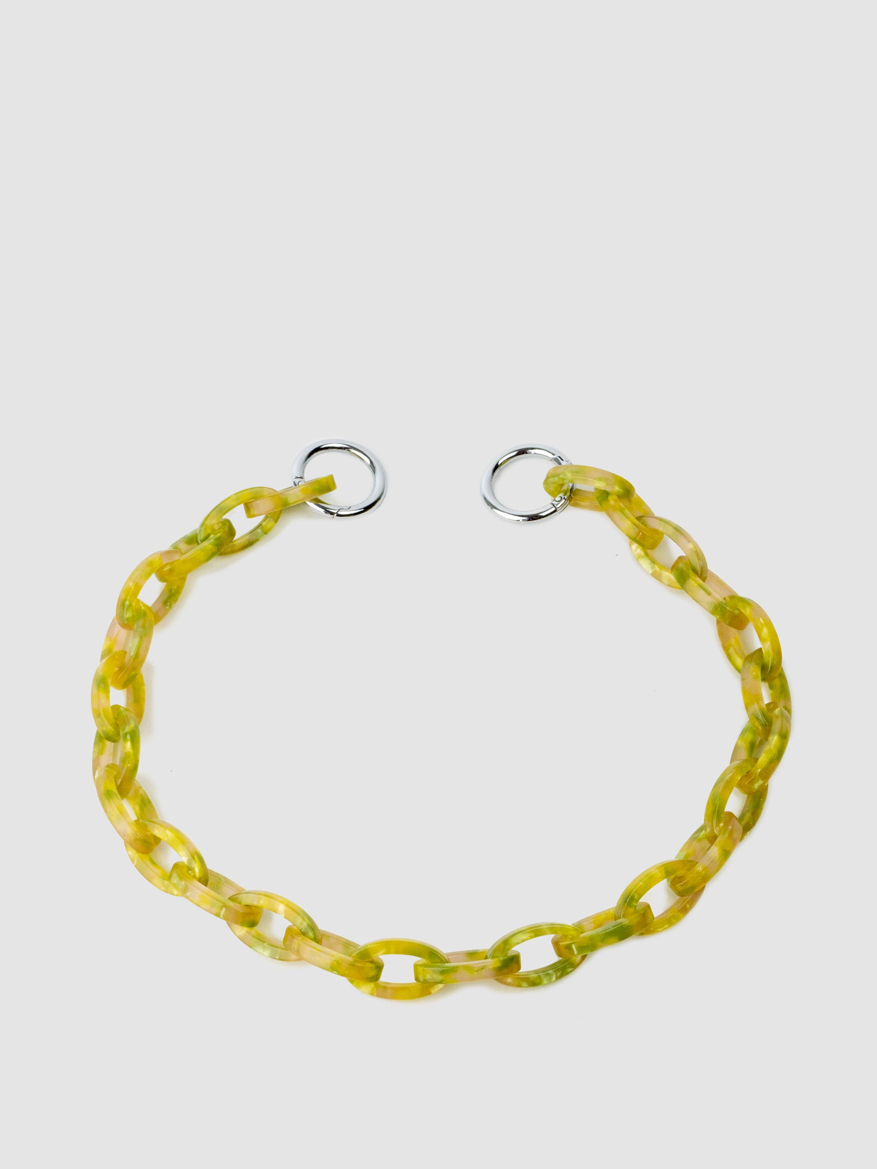 "The SONYA LEE  7 bag chain. Unique acrylic chain in yellow and green. Each chain is 20"" in length and can be used multiple ways. Update your Victoria bag, other bags, or wear as a necklace."