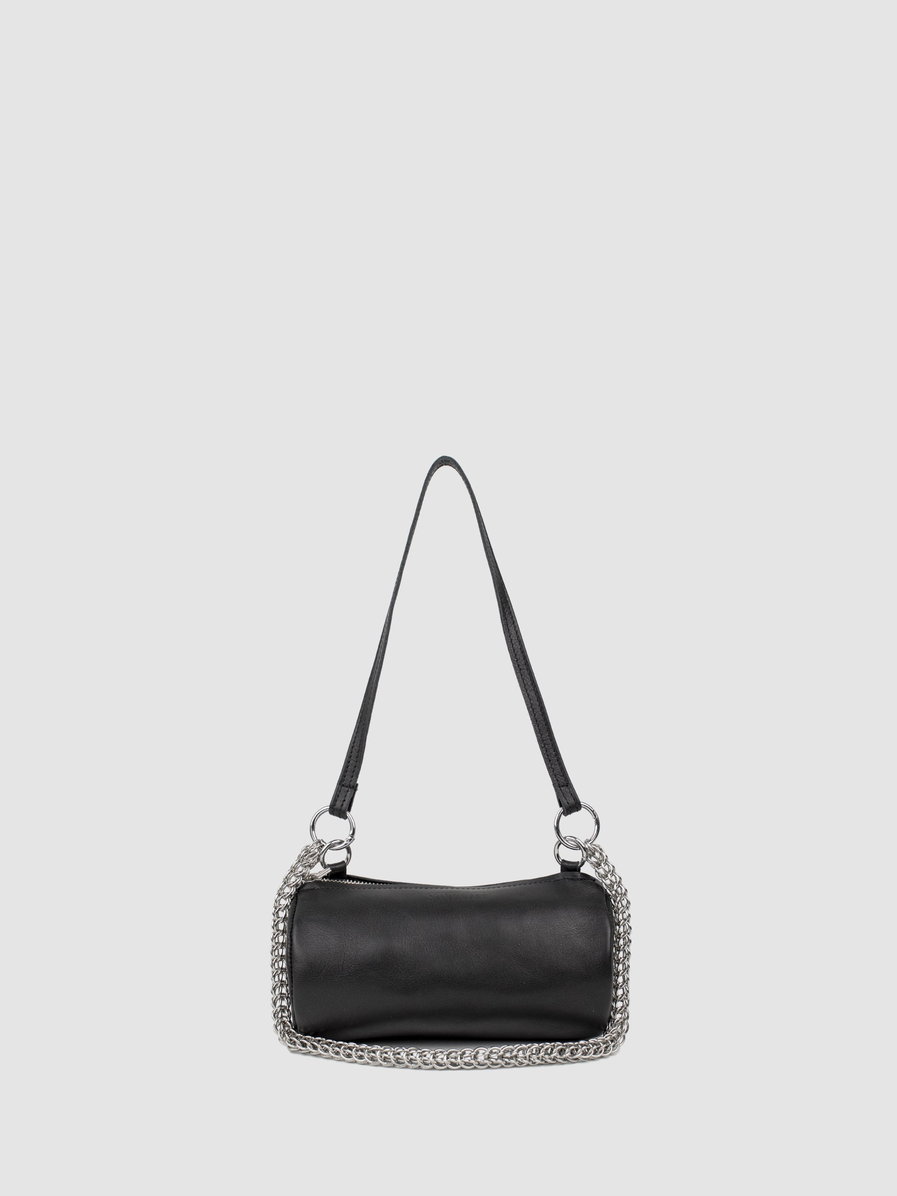 The SONYA LEE Georgia mini barrel bag in soft black serpentine chain. Ethically handmade in Canada using full grain leather. Lifetime warranty. Fits all the essentials. Adjustable leather strap for crossbody and handheld wear. Free shipping across North America.
