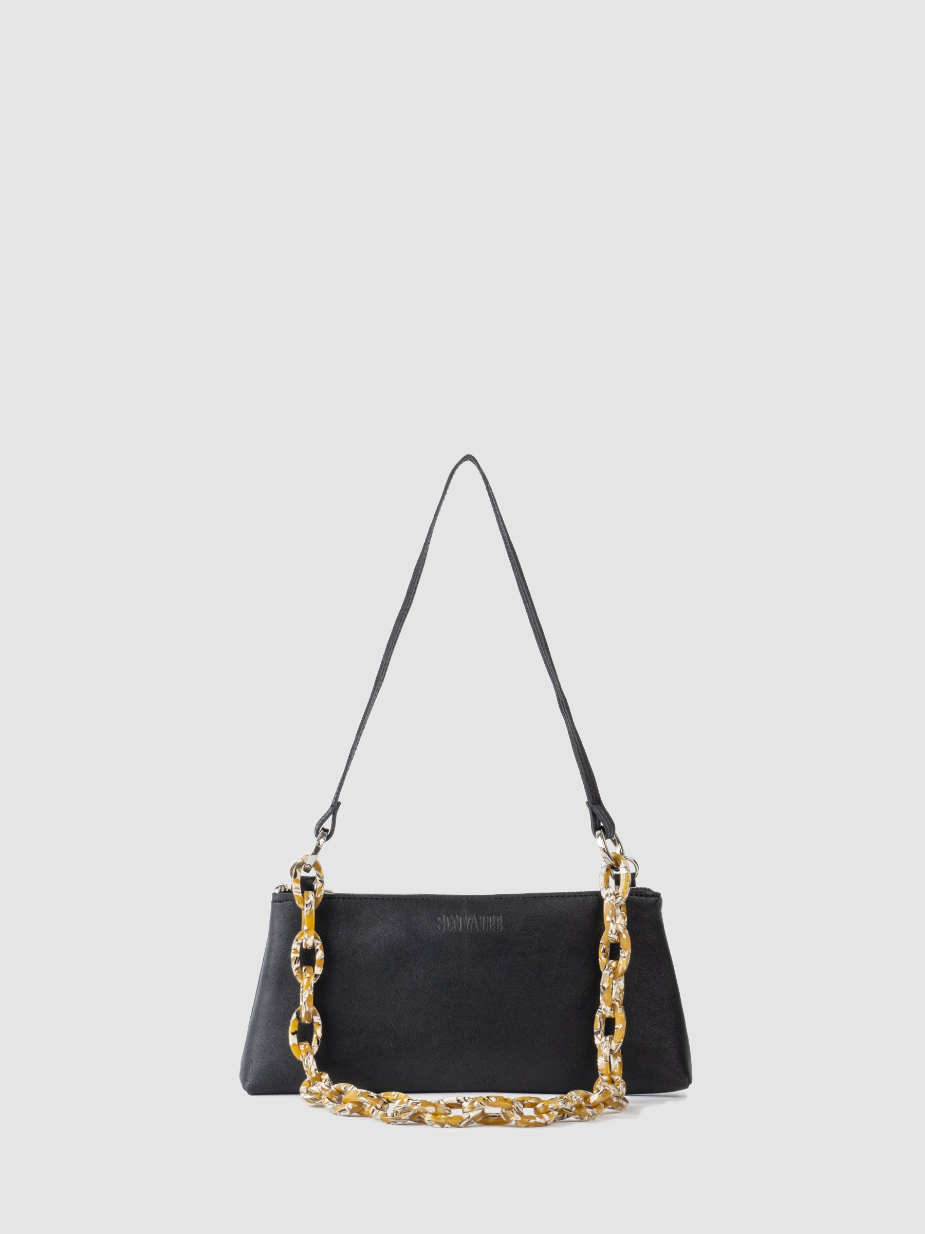 The SONYA LEE Maya mini bag in soft black leather with affogato chain . Ethically handmade in Canada using full grain leather. Lifetime warranty. Fits all the essentials. Zipper Closure. Leather and chain shoulder strap. Free shipping across Canada.