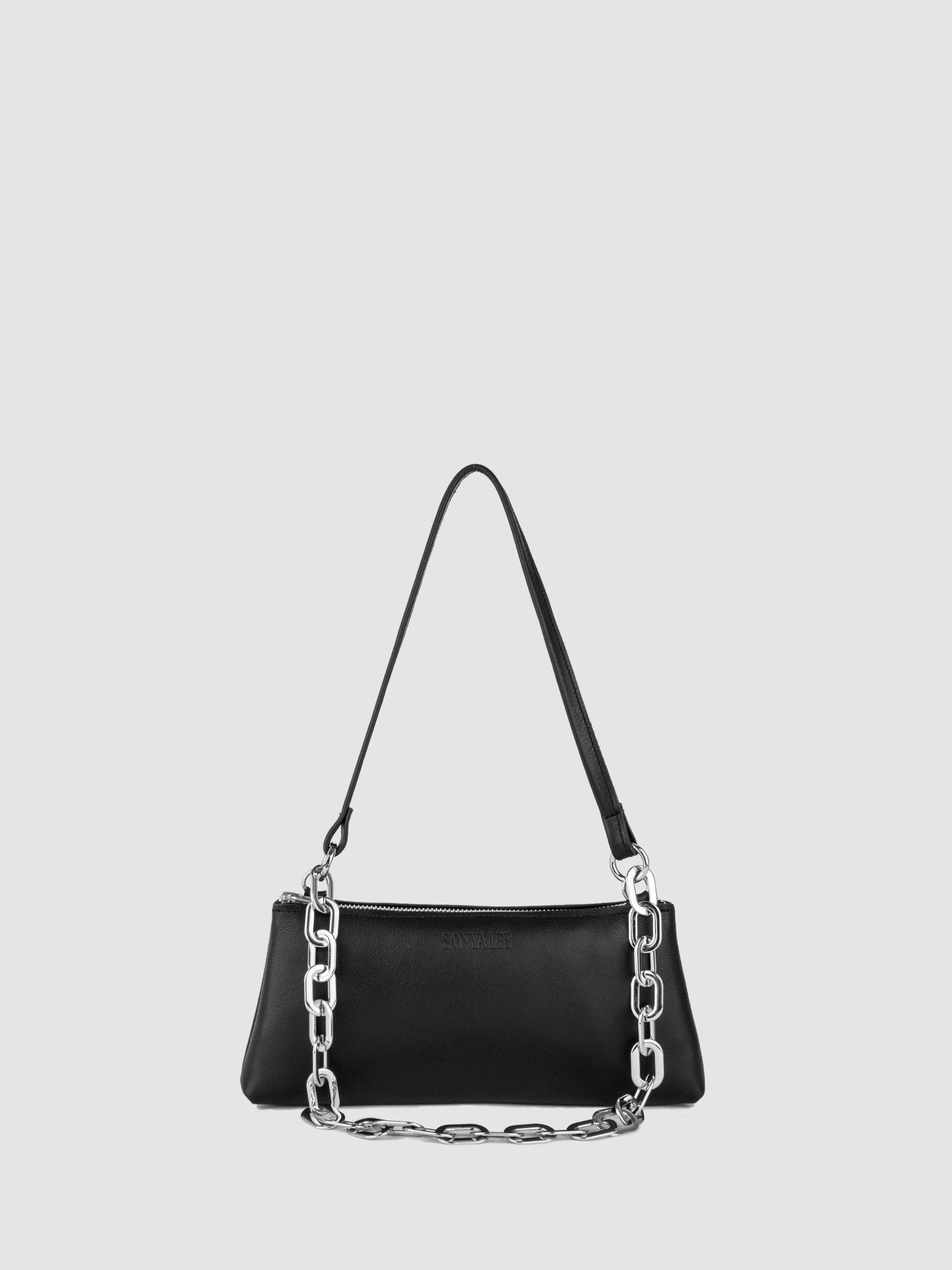 The SONYA LEE Maya mini bag in soft black leather with Oval chain . Ethically handmade in Canada using full grain leather. Lifetime warranty. Fits all the essentials. Zipper Closure. Leather and chain shoulder strap. Free shipping across Canada.